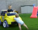 kid pushing car